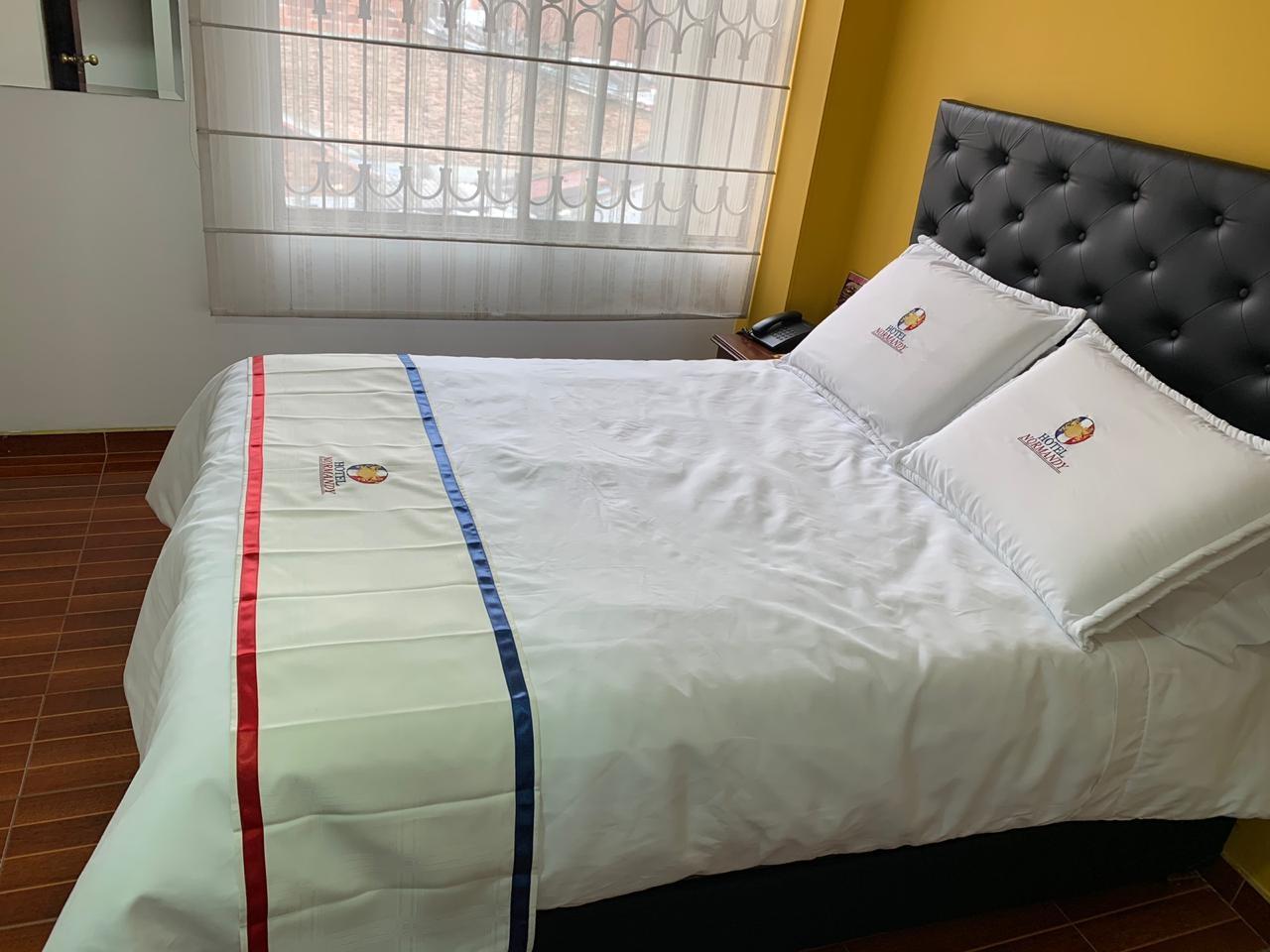 Habitación Matrimonial en Hotel Normandy : MotelNow