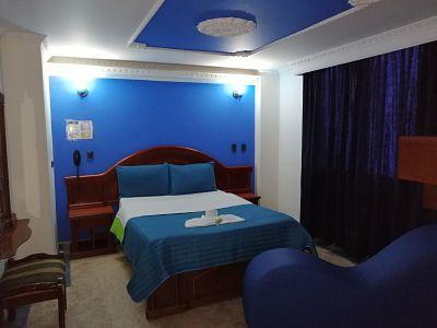 Habitación Sencilla con Silla del amor en Suite Vulcano Real : MotelNow