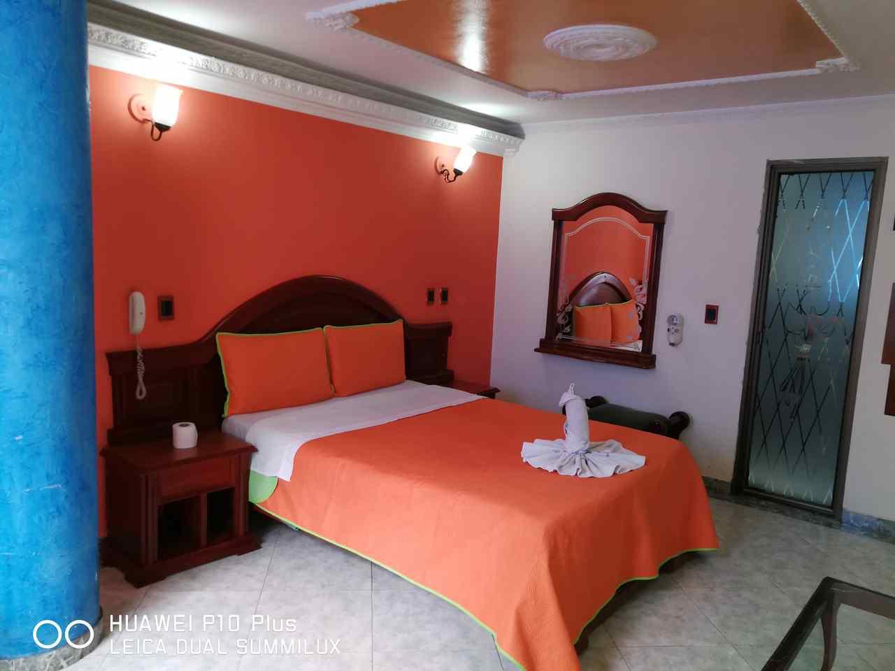 Habitación Sencilla con sofá en Suite Vulcano Real : MotelNow