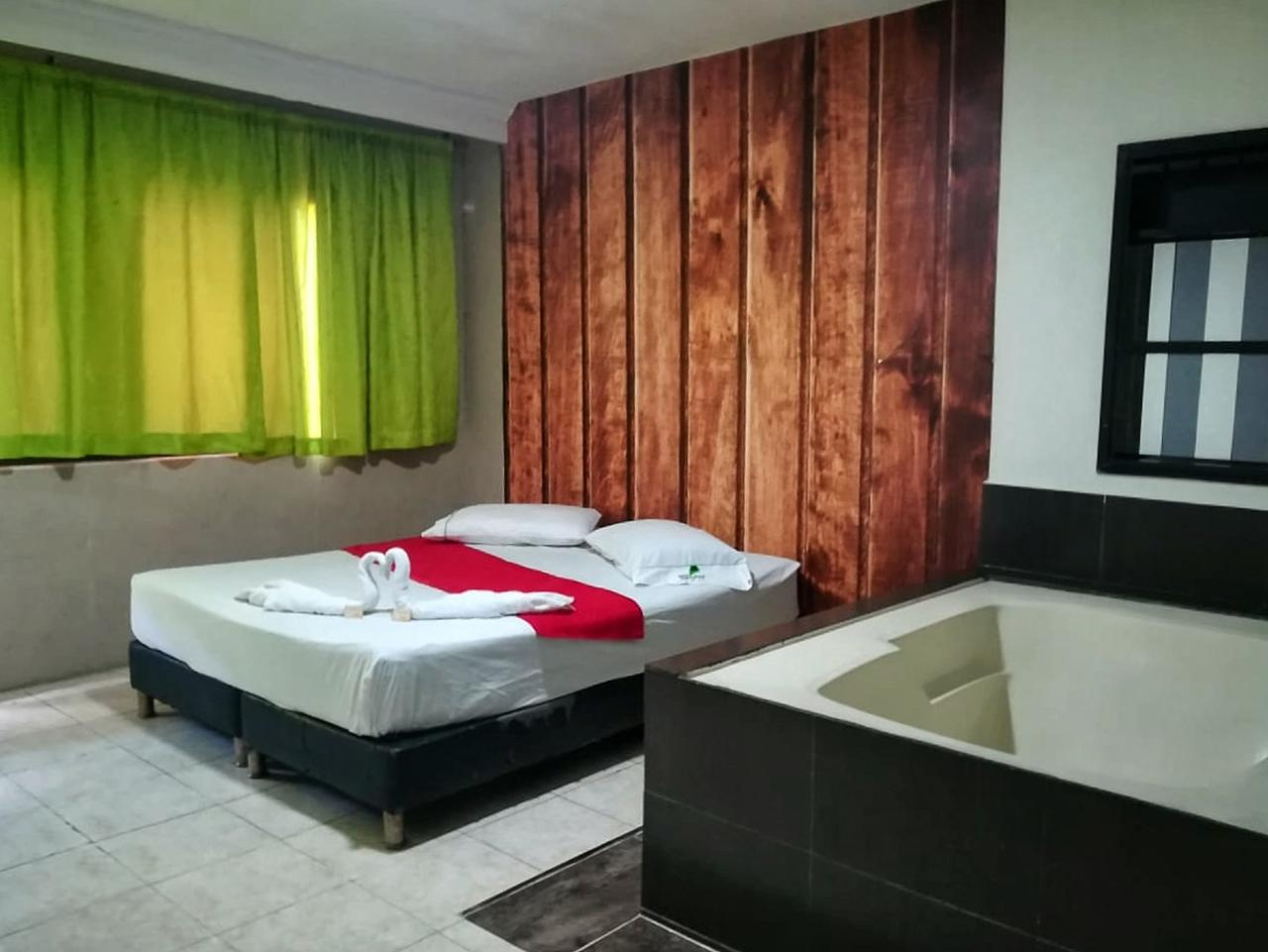 Habitación Bañera en Paradise 33 : MotelNow