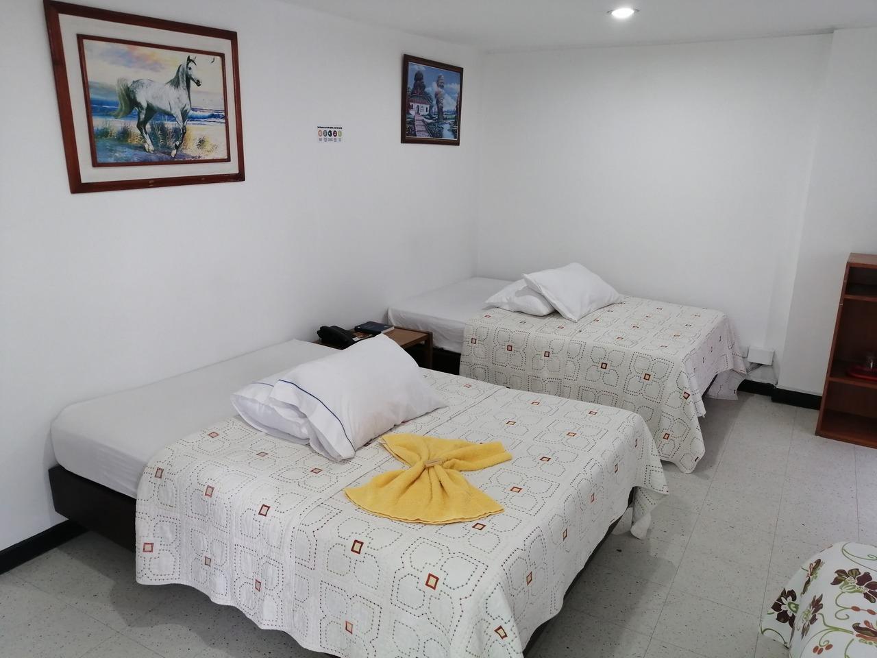 Habitación Acomodación Triple  en Hotel Teusaca : MotelNow