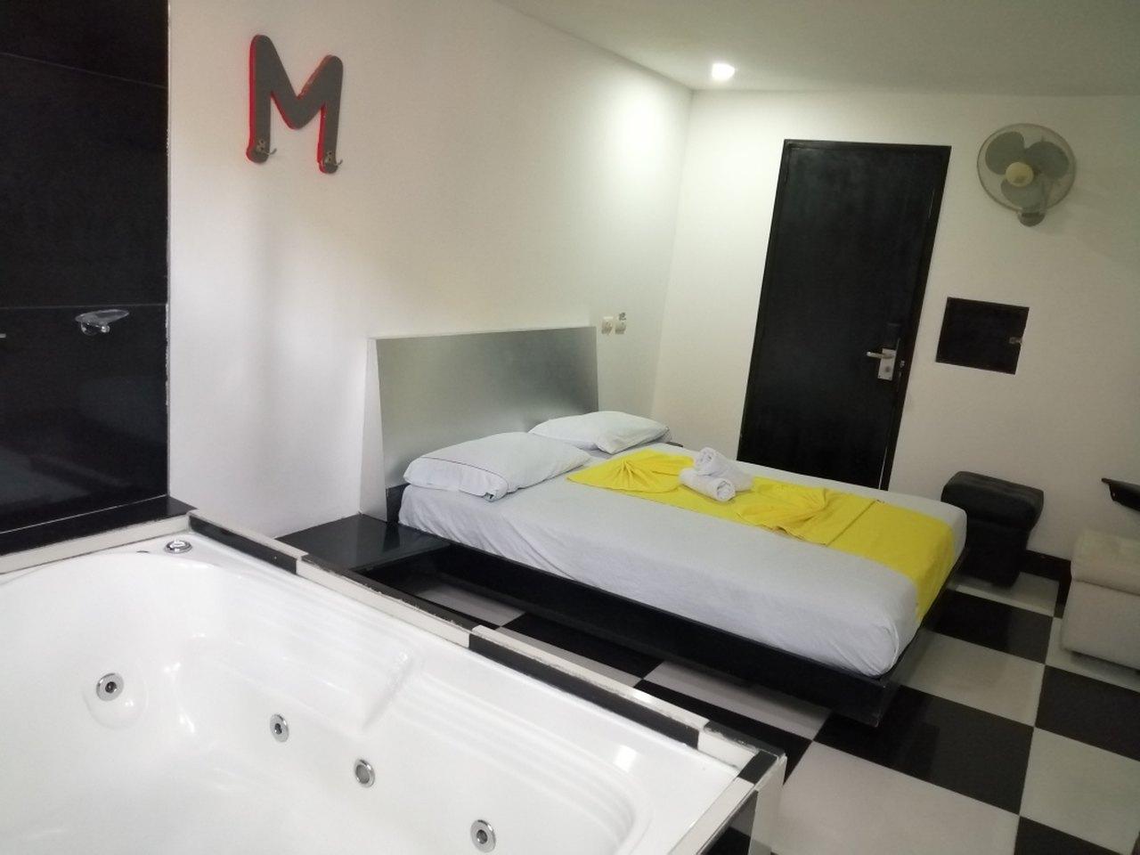 Habitación Bañera en Momentos Suite : MotelNow